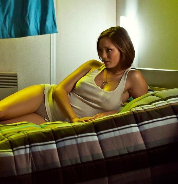 Pom Klementieff on bed