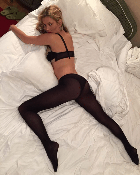 cara delevingne on bed