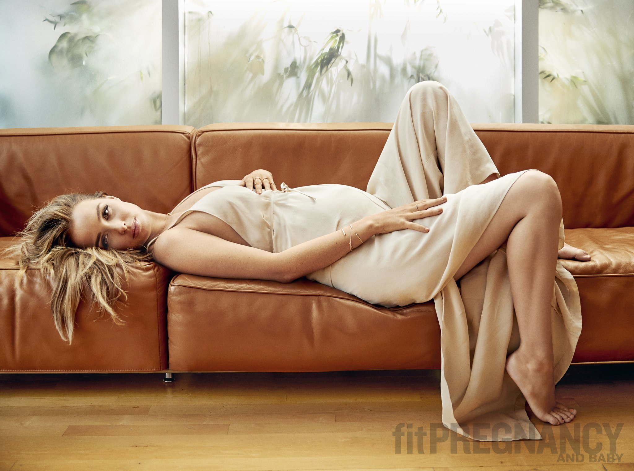 Camilla Luddington Laying on a Sofa