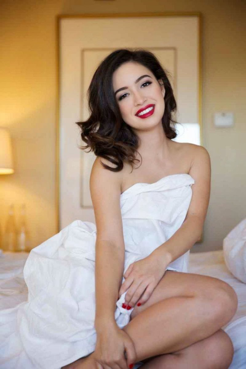 Christian Serratos on Bed