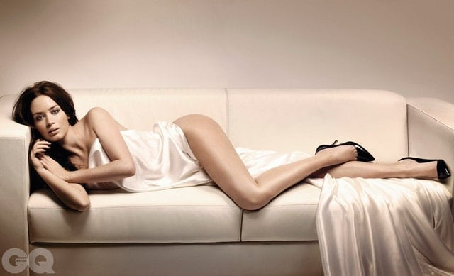 Emily Blunt Laying on a Sofa