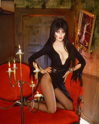 cassandra peterson in red sofa