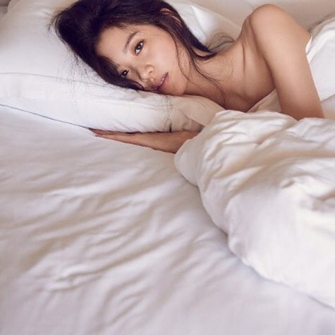 Claudia Kim on Bed