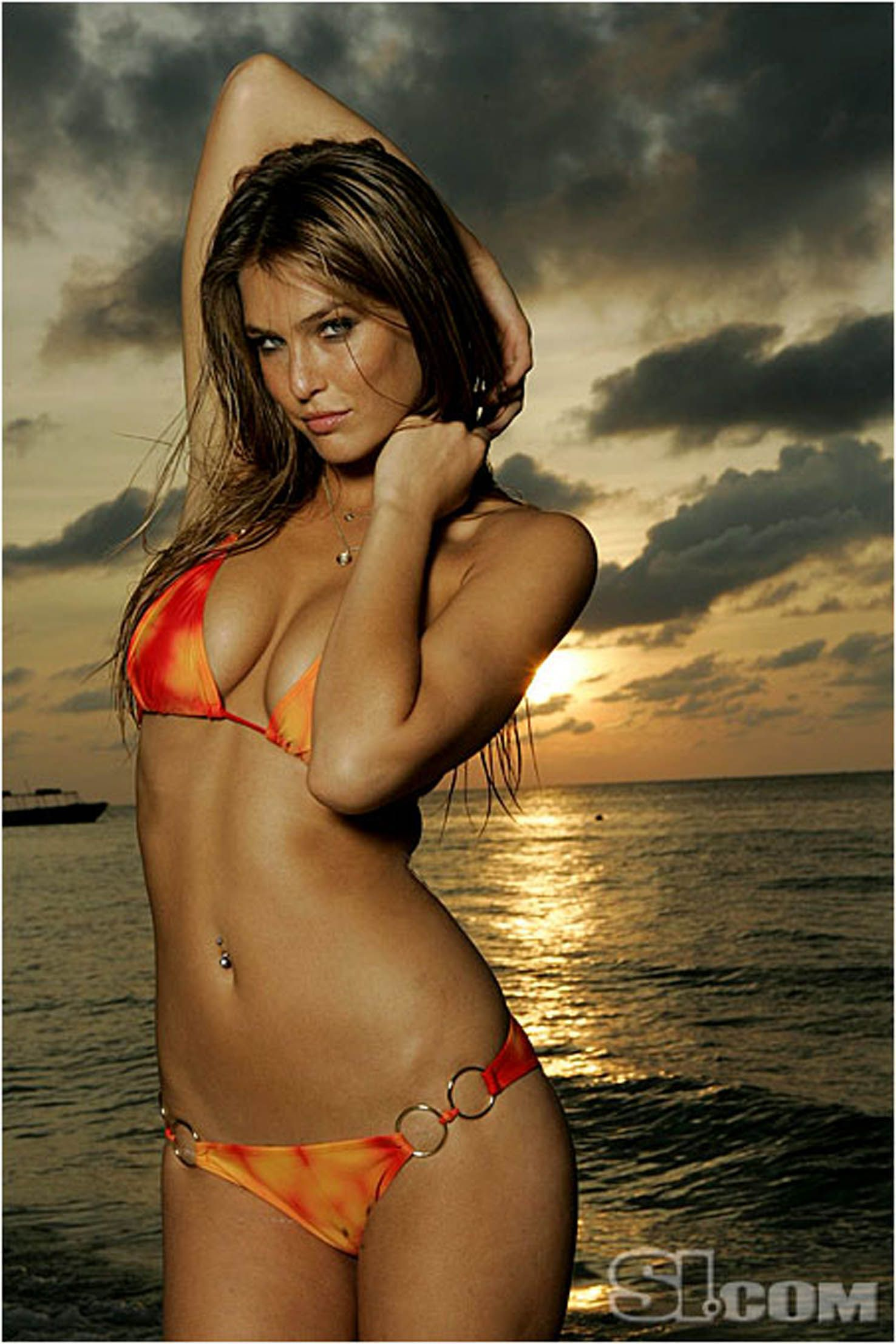 Bar refaeli gets wet in the maldives