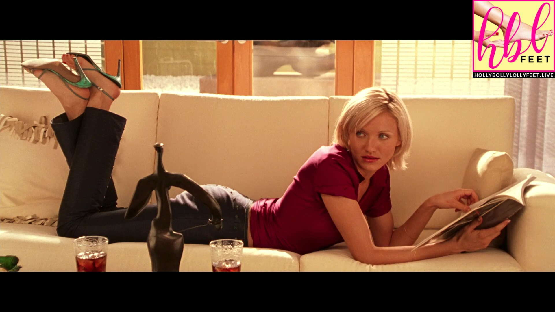 Cameron Diaz resting on couch