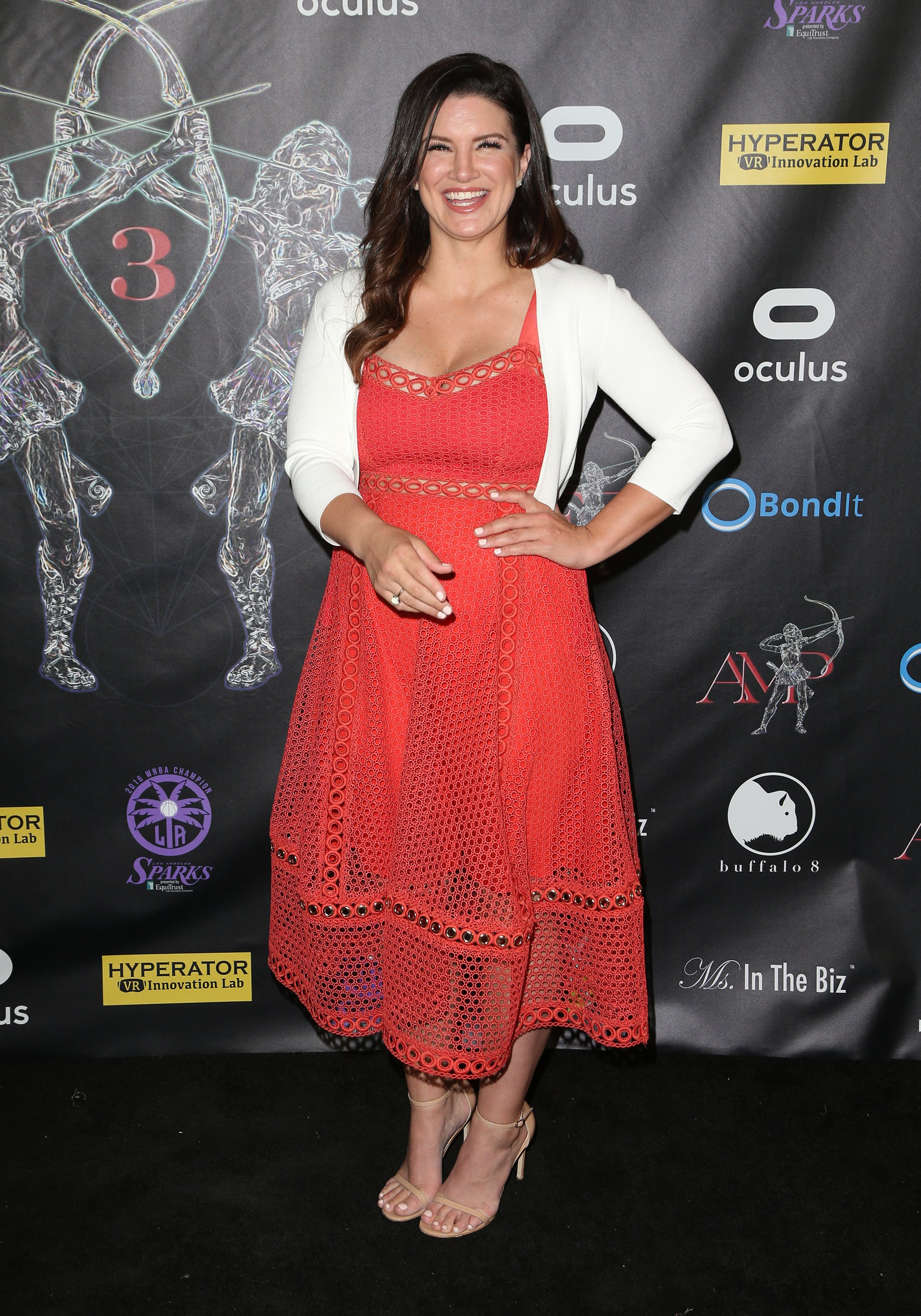 Gina Carano hot cleavage in red