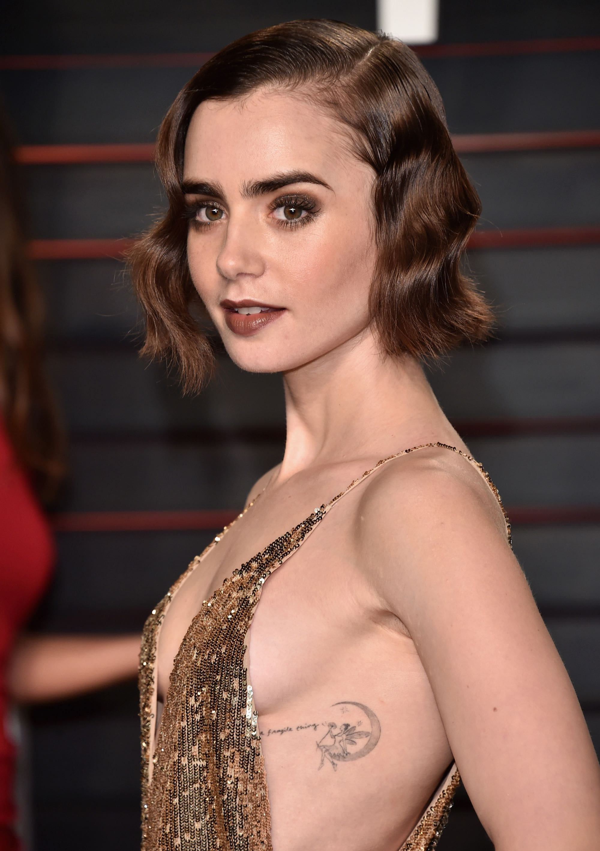 Lily Collins side boobs