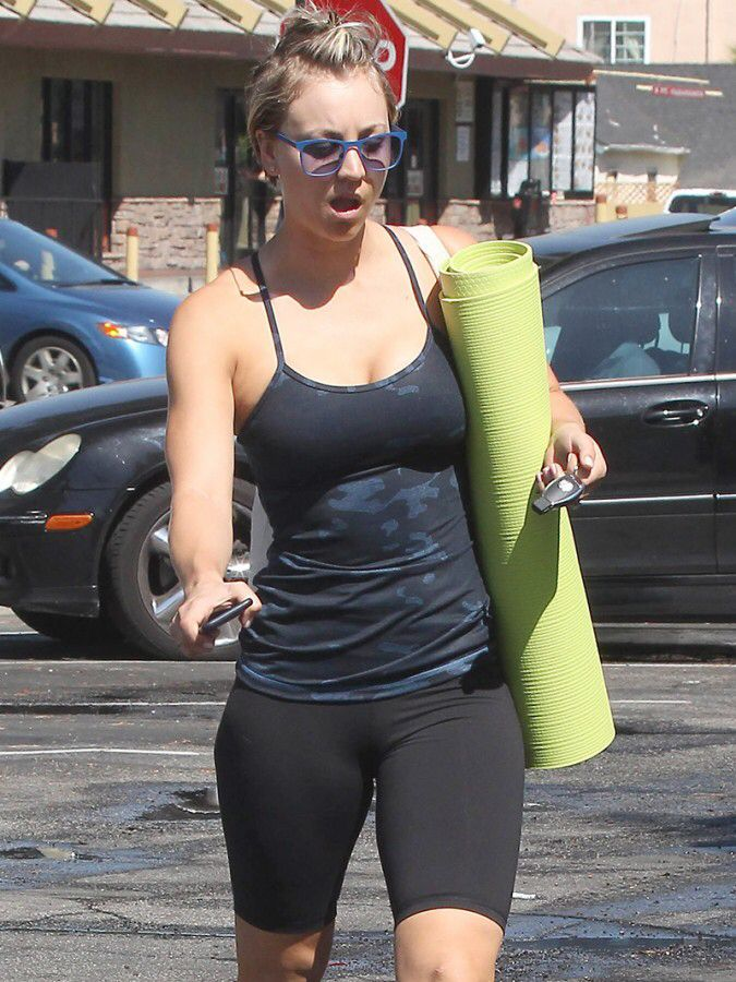 Kaley Cuoco sexy with yoga mat