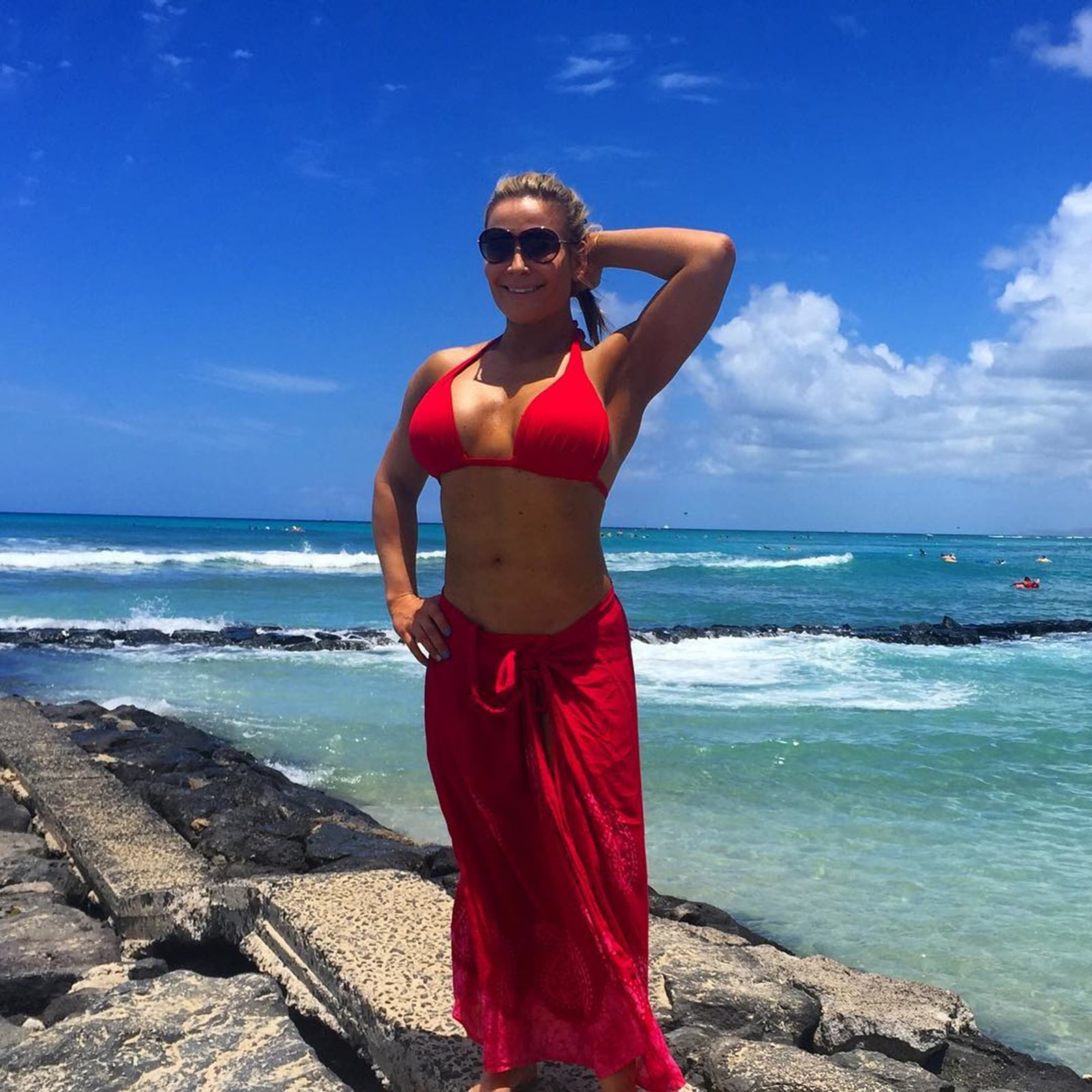 Natalya Sexy Boobs Pictures in Red Bikini