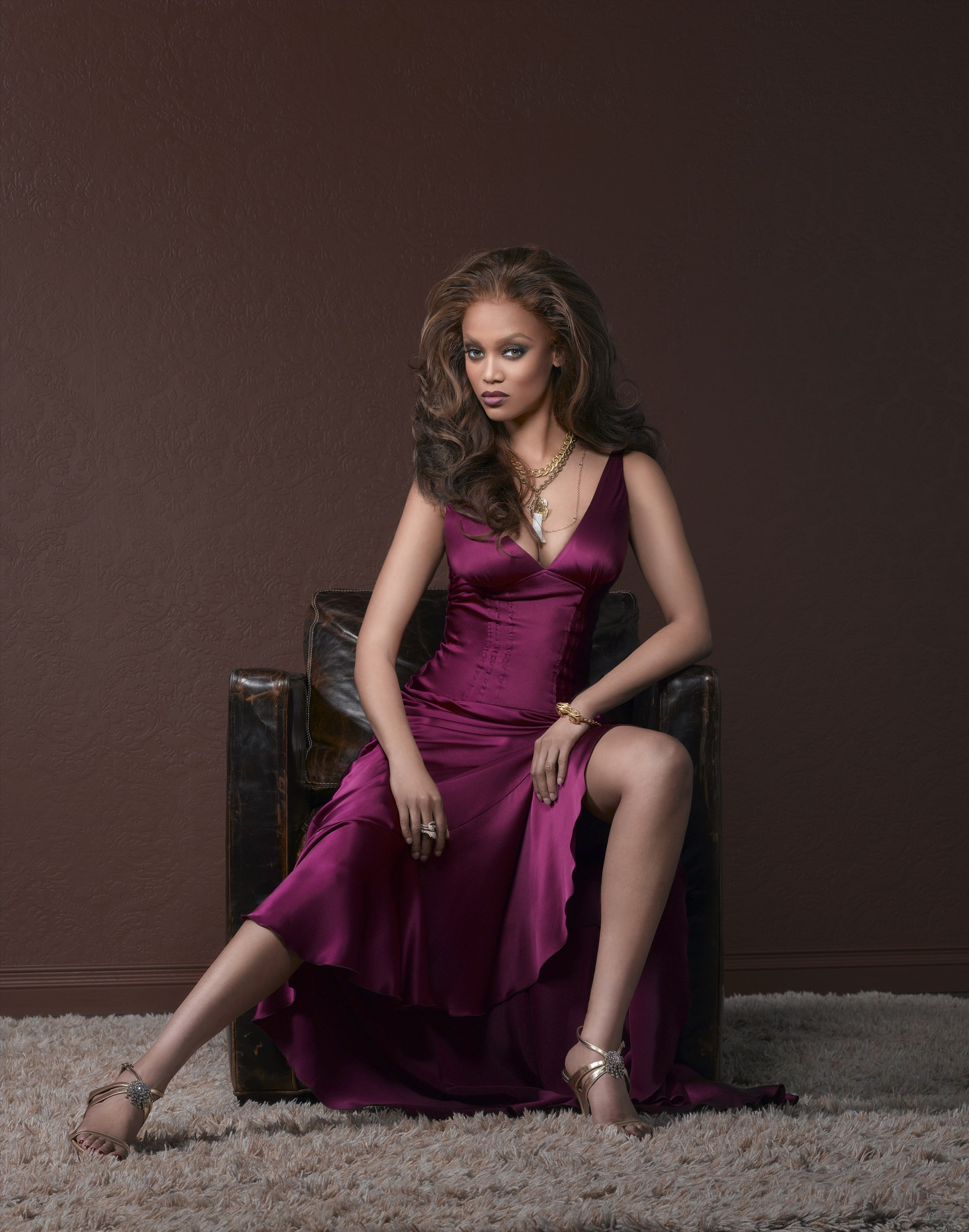 Tyra Banks hot in maroon