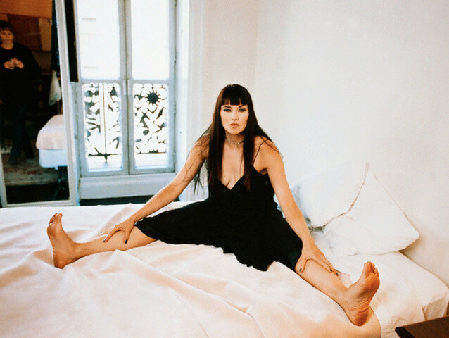 lucy lawless on bed