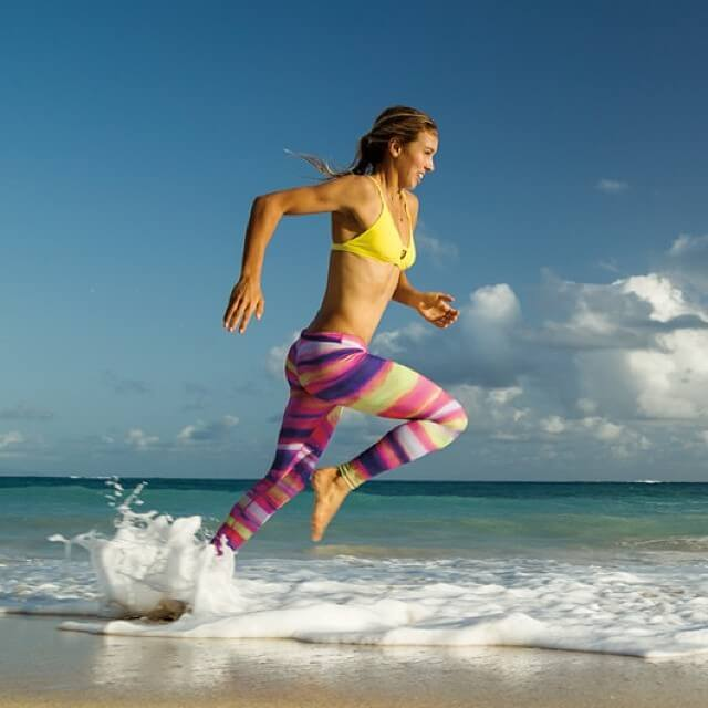 sally fitzgibbons running on the beach