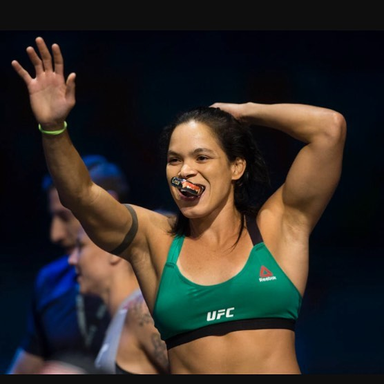 Amanda Nunes Hot in Green Sports Wear