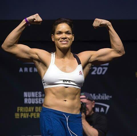 Amanda Nunes Showing Muscle