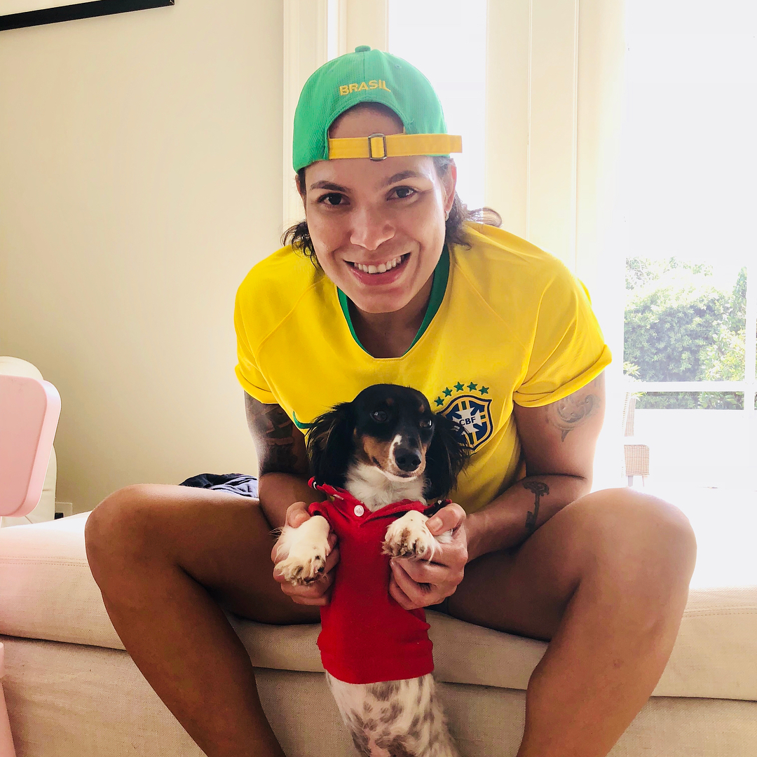 Amanda Nunes with Small Puppy