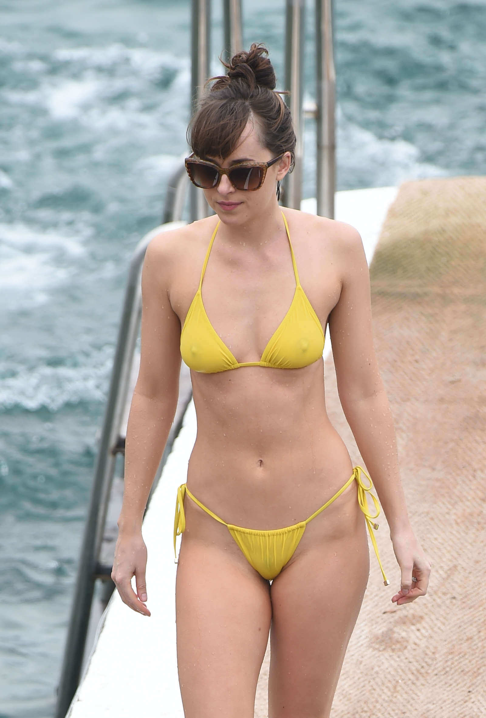 Dakota Johnson yellow bikini pic