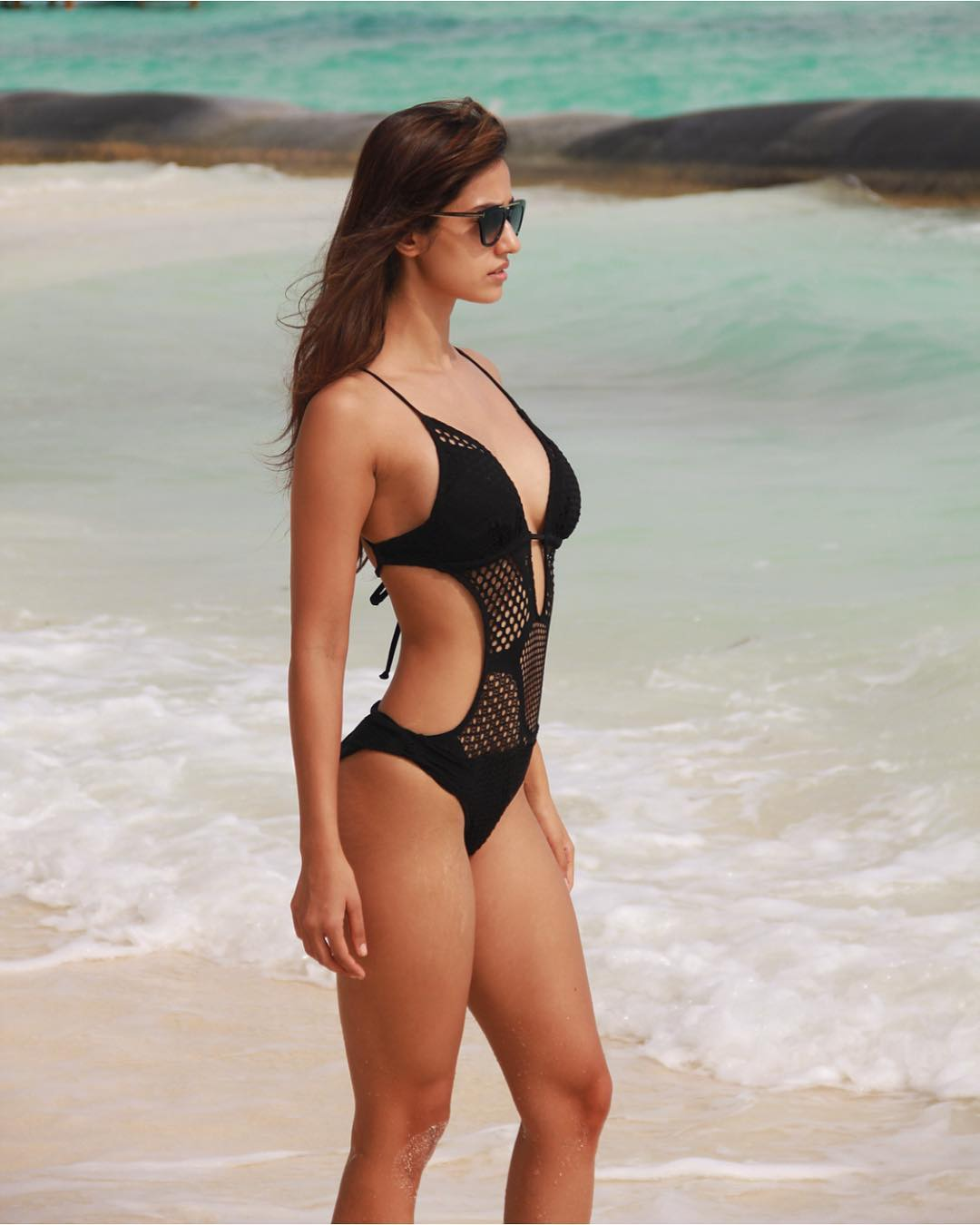 Disha Patani Sexy Boobs Pics on Black Swimming Costume