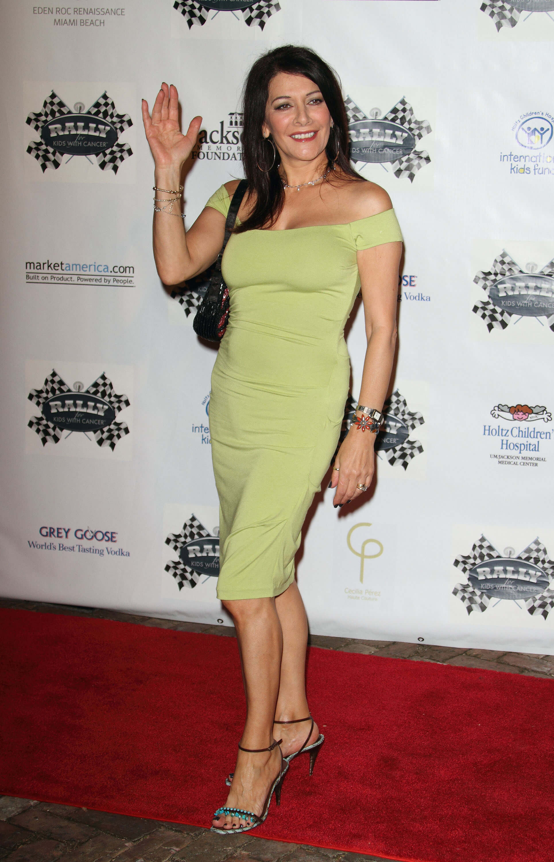 Marina Sirtis hot green dress