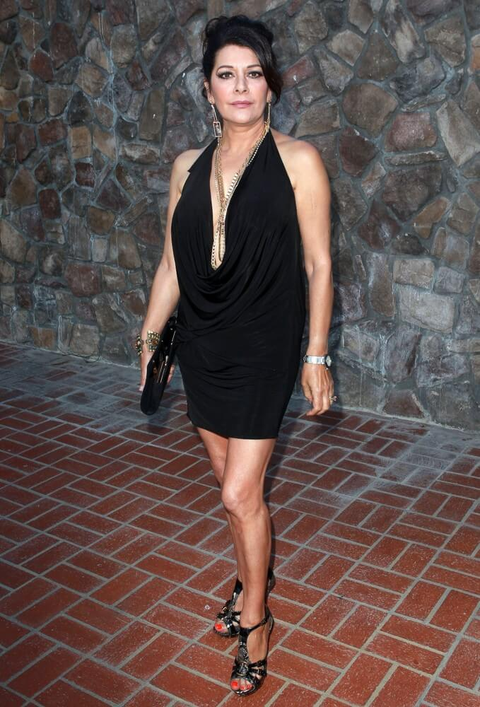 Marina Sirtis sexy black dress