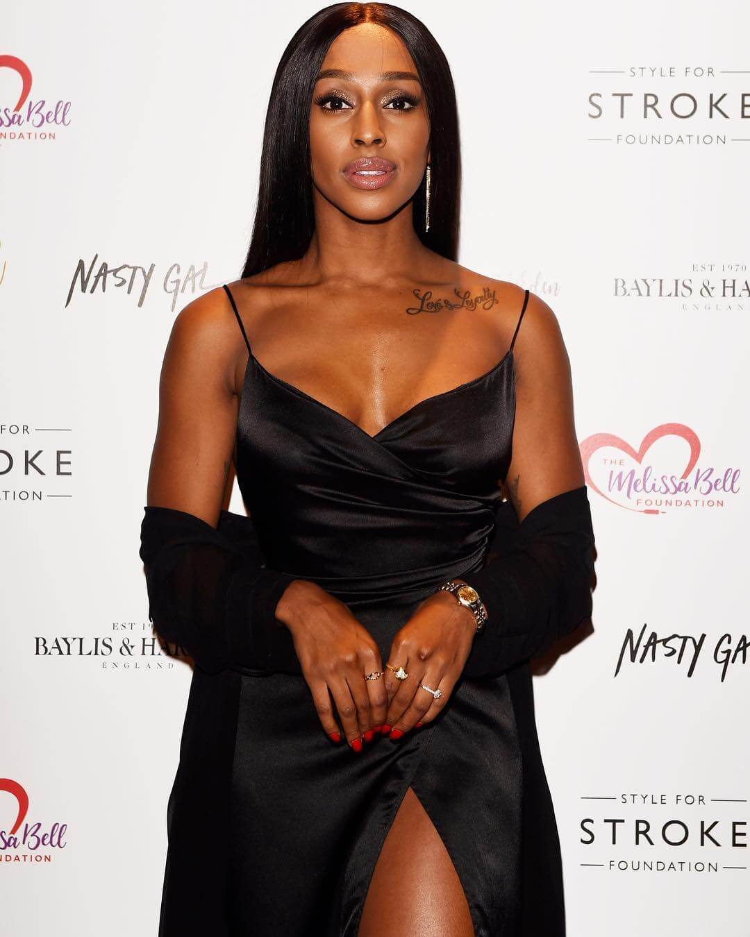 Alexandra Burke sexy black dress pic