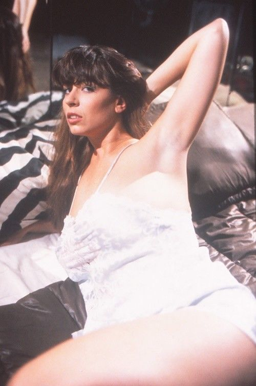 Christy Canyon on Bed