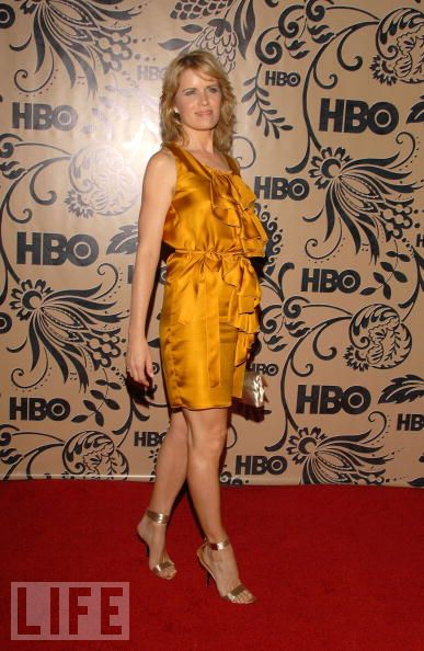 Kim Dickens Hot in Orange Dress