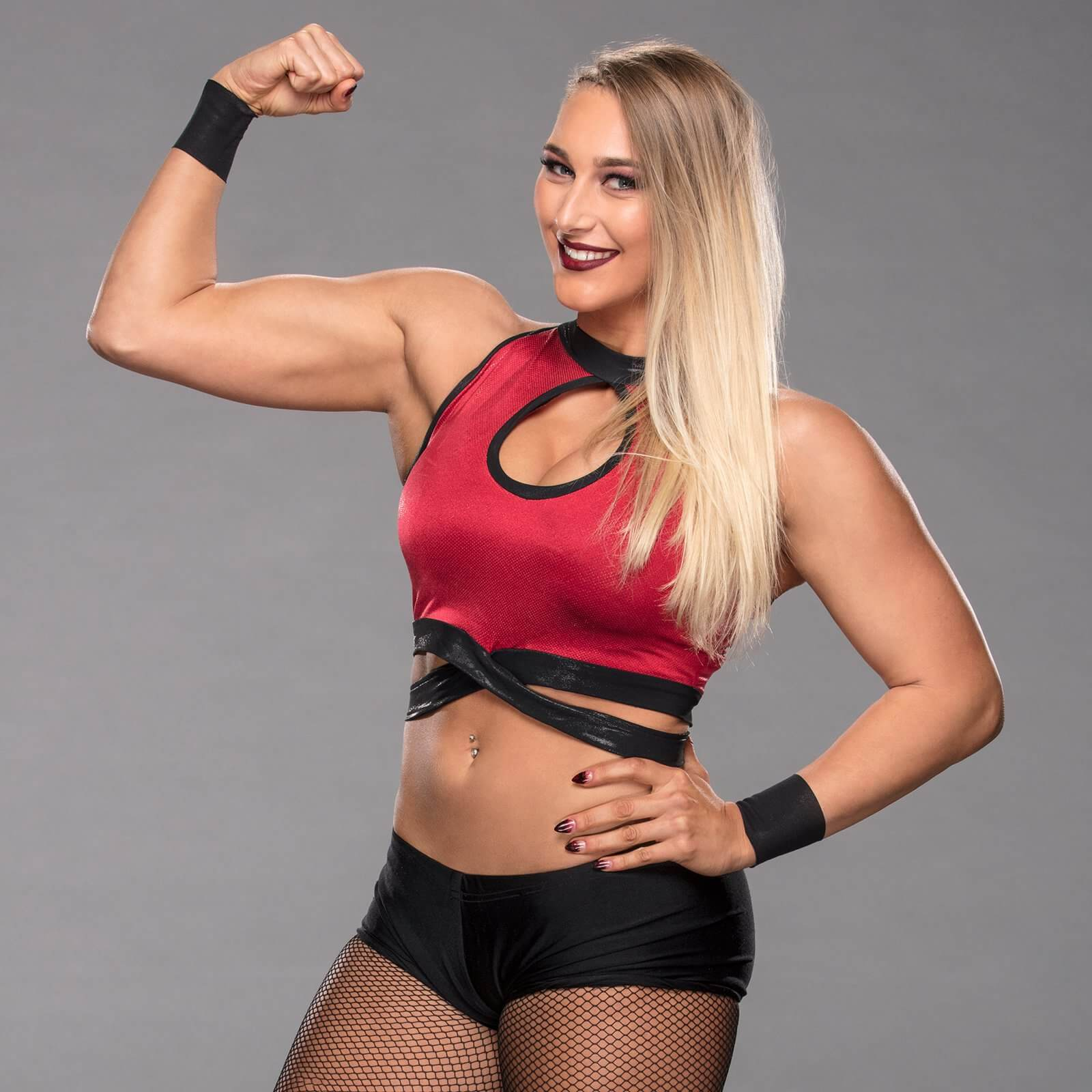 WWE Prohibits Rhea Ripley From Getting Tattoos On Her Body 5