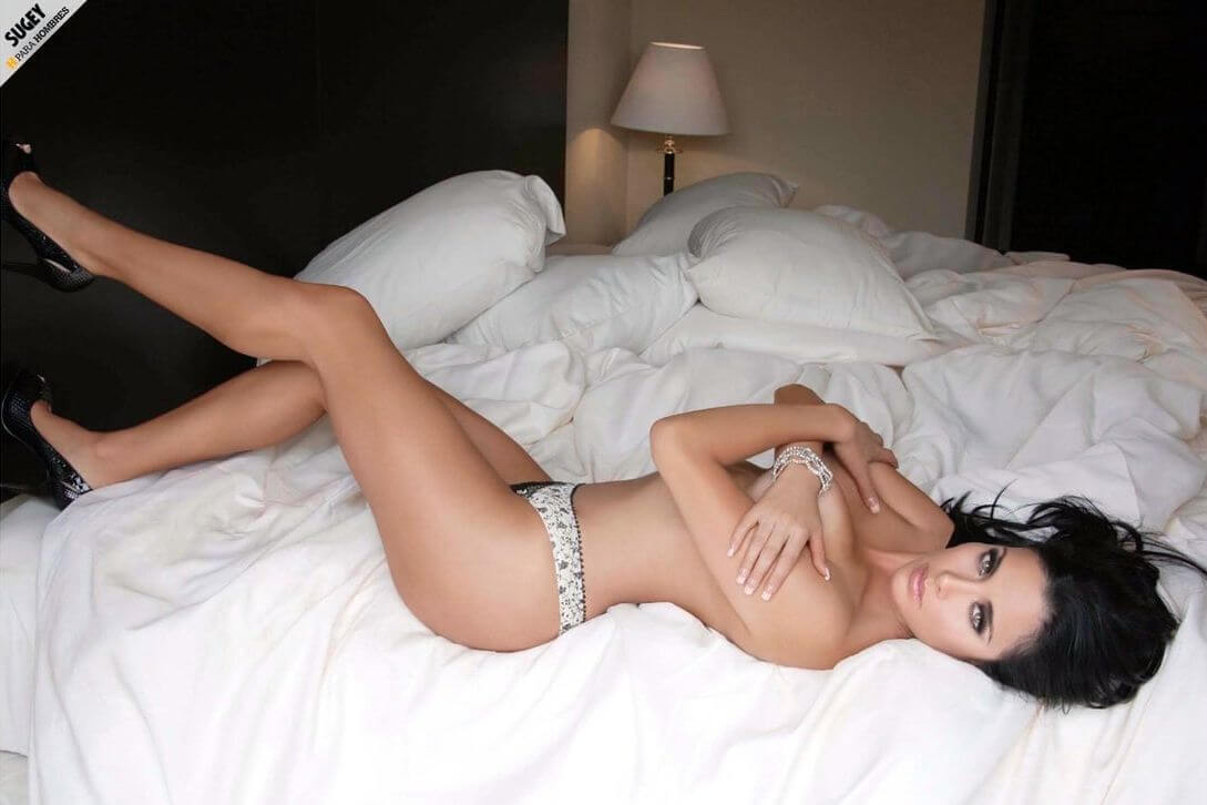 sugey abrego on the bed