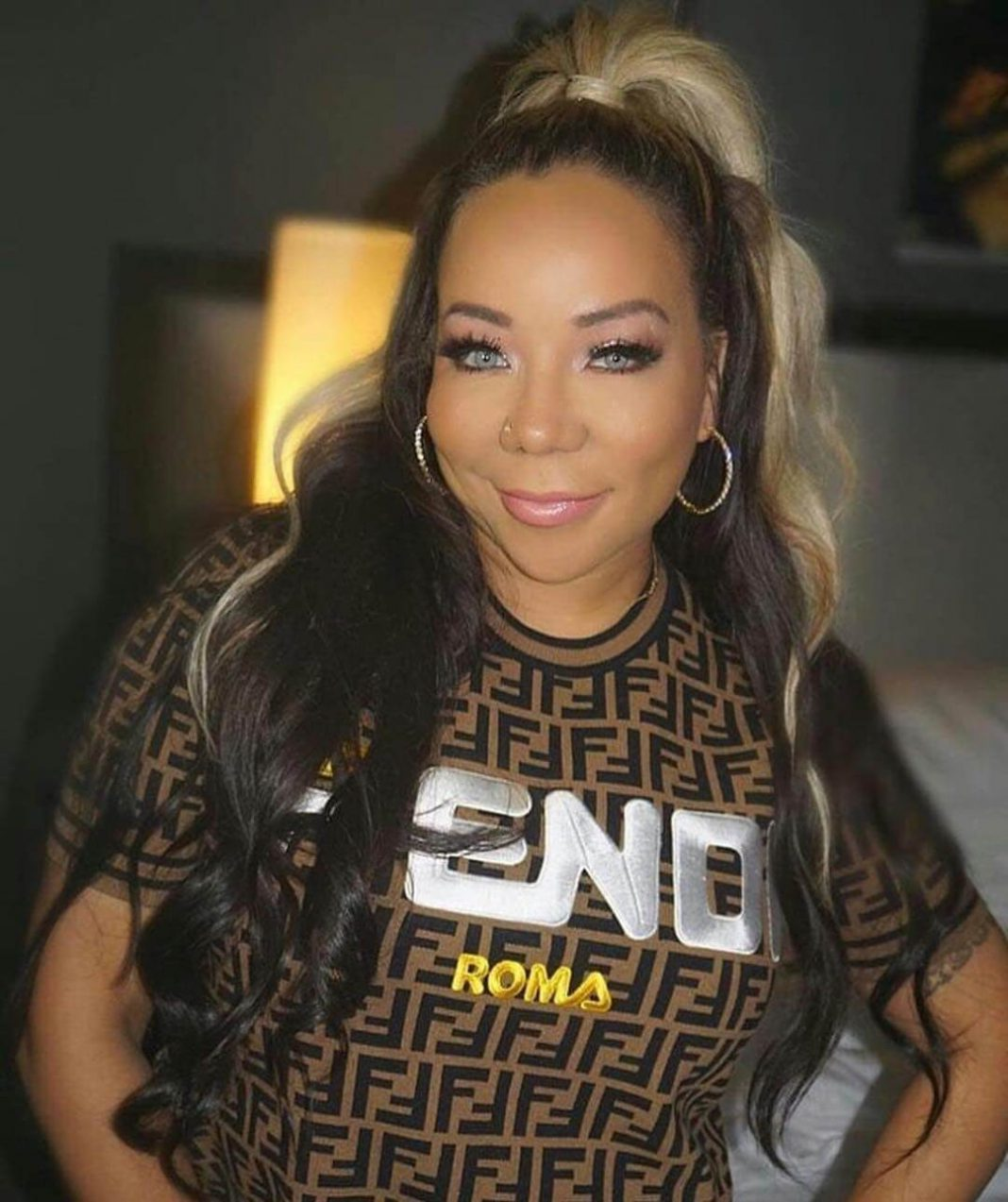 Ti's stepdaughter zonnique pullins arrested taking a gun onto plane in