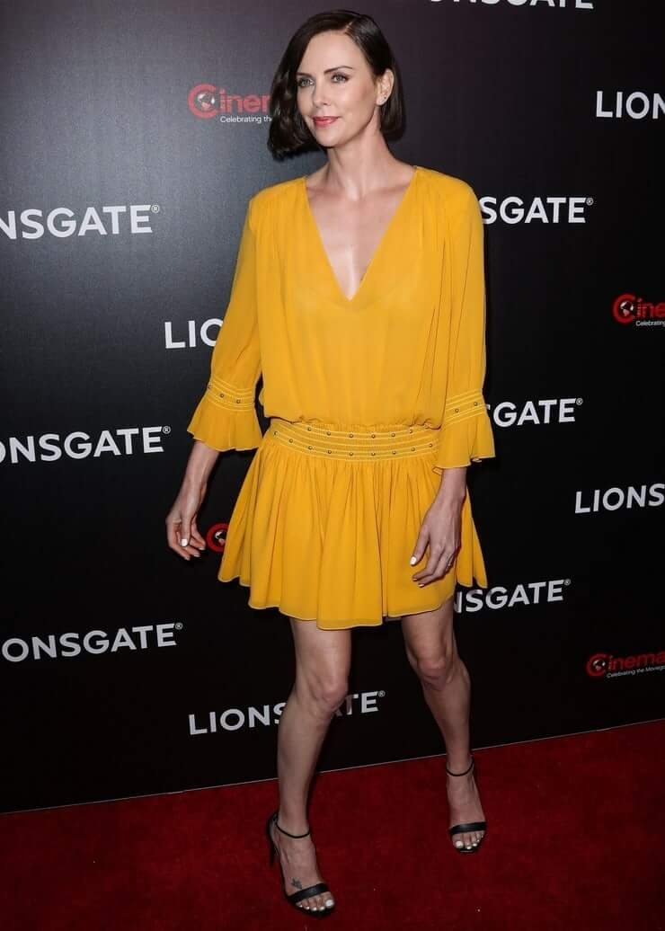 Charlize Theron sexy yellow dress