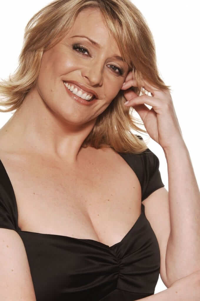 Laurie Brett sexy cleavage pic
