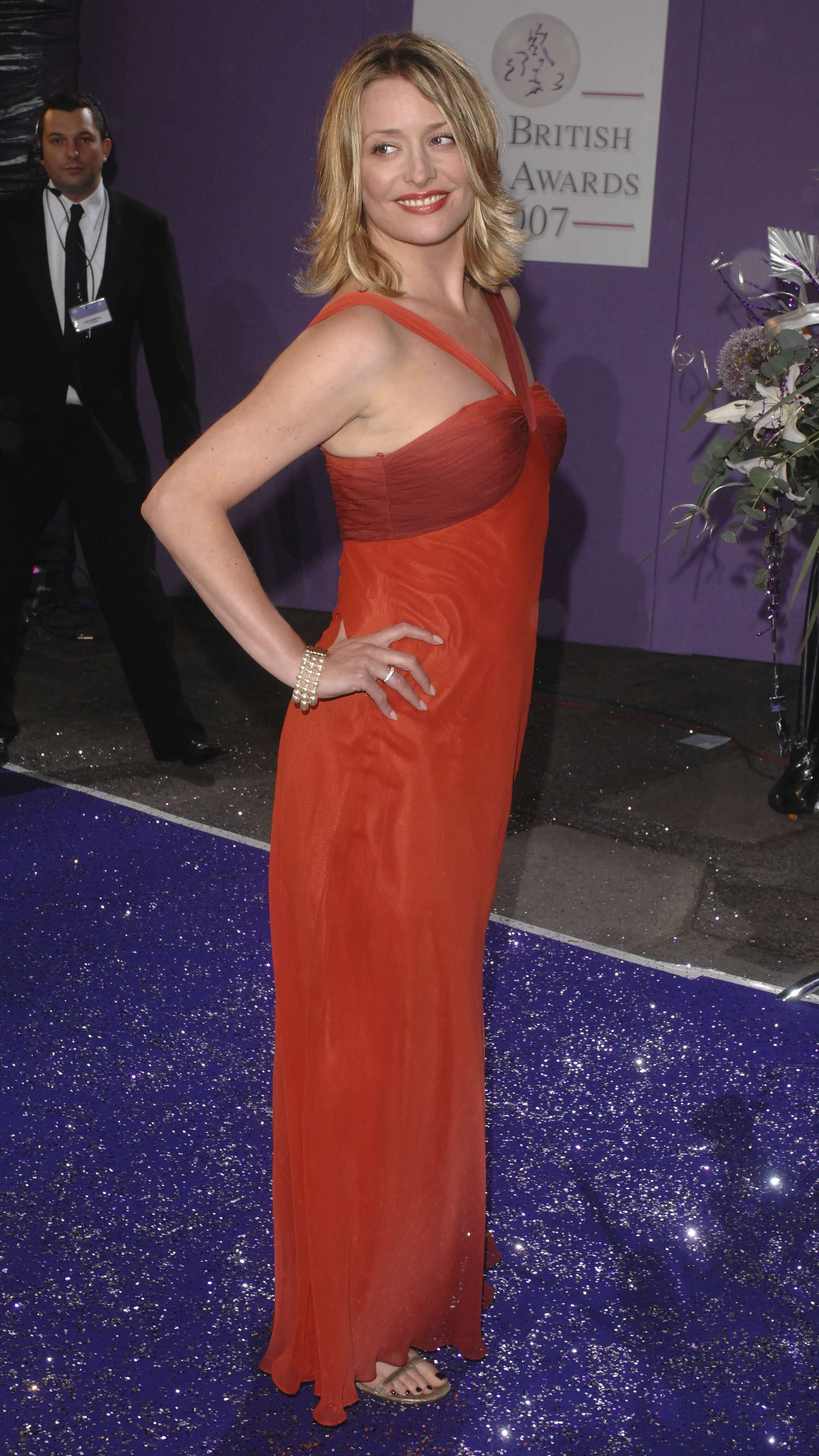 Laurie Brett sexy long red dress