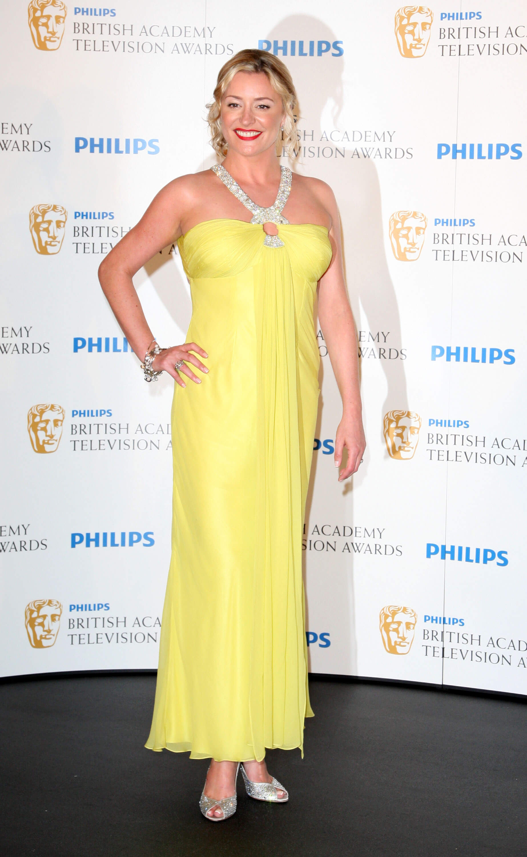 Laurie Brett sexy yellow dress pic
