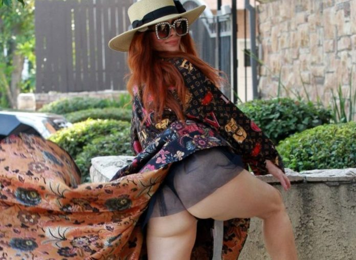 Phoebe Price Flaunts Her Curves In Louis Vuitton Dress As She Takes Her Dog For a Walk